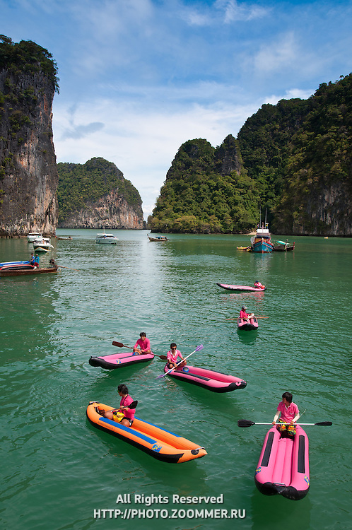 Tourists canoeing in the national marine park of Phang Nga Bay, Thailand