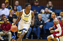 Nov 28, 2018; Morgantown, WV, USA; West Virginia Mountaineers forward Wesley Harris (21) dribbles the ball during the first half against the Rider Broncs at WVU Coliseum. Mandatory Credit: Ben Queen-USA TODAY Sports