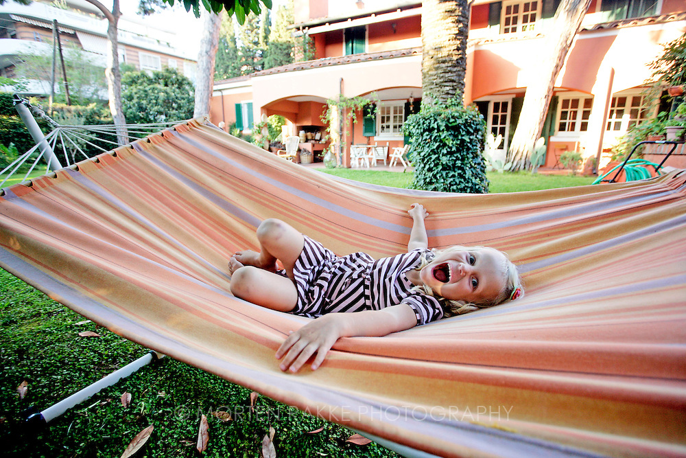 Young girl playing in hammock, Italy