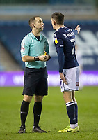 Millwall's Jed Wallace has words with Referee Jeremy Simpson<br /> <br /> Photographer Rob Newell/CameraSport<br /> <br /> The EFL Sky Bet Championship - Millwall v Watford - Tuesday 26th January 2021 - The Den - London  <br /> <br /> World Copyright © 2021 CameraSport. All rights reserved. 43 Linden Ave. Countesthorpe. Leicester. England. LE8 5PG - Tel: +44 (0) 116 277 4147 - admin@camerasport.com - www.camerasport.com