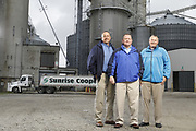 SHOT 10/29/18 9:47:26 AM - Sunrise Cooperative is a leading agricultural and energy cooperative based in Fremont, Ohio with members spanning from the Ohio River to Lake Erie. Sunrise is 100-percent farmer-owned and was formed through the merger of Trupointe Cooperative and Sunrise Cooperative on September 1, 2016. Photographed at the Clyde, Ohio grain elevator was George D. Secor President / CEO and John Lowry<br /> Chairman of the Board of Directors with  CoBank RM Gary Weidenborner. (Photo by Marc Piscotty © 2018)