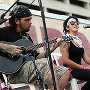 "A member of the band Probable Cause sings while on stage at ""Camp Romney"", during the Republican National Convention in Tampa, Fla. on Wednesday, August 29, 2012. (AP Photo/Alex Menendez)"