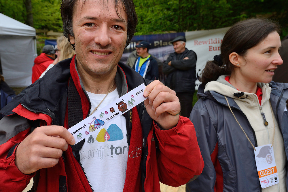 Mountain bike Marathon organiser, with the marathon named after the bison, Zimbru, at the release of European bison, Bison bonasus, in the Tarcu mountains nature reserve, Natura 2000 area, Southern Carpathians, Romania. The release was actioned by Rewilding Europe and WWF Romania in May 2014.