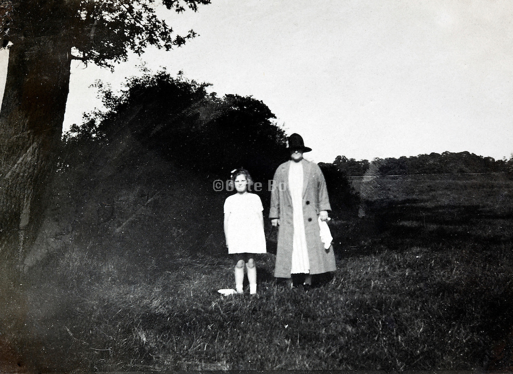 mother and child posing out in an open field
