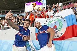 September 20, 2019, Tokyo, Japan: (L to R) Russia's German Davyodov and Stanislav Selskii pose for a selfie with fans after ended the Pool A match between Japan and Russia at Tokyo Stadium. Japan defeats Russia 30-10. (Credit Image: © Rodrigo Reyes Marin/ZUMA Wire)