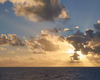Pacific Ocean Sunset from the MV World Odyssey. Fuji X-T1 camera and 35 mm f/1.4 lens (ISO 200, 35 mm, f/16, 1/250 sec).