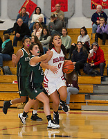 Belmont's Julianna Estremera looks to the basket with pressure from Newfound's Madi Dalphonse during NHIAA division III basketball Friday evening.  (Karen Bobotas/for the Laconia Daily Sun)