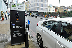 © Licensed to London News Pictures. 08/04/2019. LONDON, UK.  An electric car in Southwark is charged at a fast roadside charging point. Electric cars are exempt from the Ultra Low Emission Zone which is in force 24 hours a day.  Coming into effect on 8 April, within the same area of central London as the Congestion Charge, most vehicles, including cars and vans, need to meet the ULEZ emissions standards or their drivers must pay a daily charge to drive within the zone.  The ULEZ is an initiative to improve air quality and public health in central London and is supported by the Mayor of London.  Photo credit: Stephen Chung/LNP