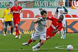 24.04.2010, Volkswagen Arena, Wolfsburg, GER, 1.FBL, VfL Wolfsburg vs 1.FC Koeln, im Bild Reinhold Yabo (Koeln #37) bringt Diego (Wolfsburg #28) zu fall .EXPA Pictures © 2011, PhotoCredit: EXPA/ nph/  Schrader       ****** out of GER / SWE / CRO  / BEL ******
