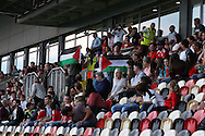 a handful of Pro-Palestine protesters © make their anti-Israel feelings known in the main grandstand ahead of the game. UEFA Womens Euro qualifying match, Wales Women v Israel Women at Rodney Parade in Newport, South Wales on Thursday 15th September 2016.<br /> pic by Andrew Orchard, Andrew Orchard sports photography.