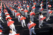 Ten thousand people perform the martial art of Taiqiquan in Beijing. The event was organized by the Beijing Sports bureau to promote sport and a healthy lifestyle. Historically, Taijiquan has been regarded as a martial art, and its traditional practitioners still teach it as one. Even so, it has developed a worldwide following among many thousands of people with little or no interest in martial training for its aforementioned benefits to health and health maintenance. Some call it a form of moving meditation.