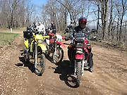 Dual sport motorcycle riders stopped along road in Arkansas