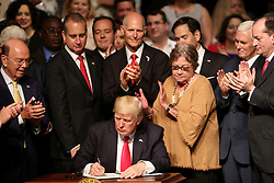 June 16, 2017 - Miami, FL, USA - President Donald Trump signs his new Cuba policy at the Manuel Artime Theateron June 16, 2017 in Miami, where he unveiled the changes he's making to the Obama-era policies toward Cuba. (Credit Image: © Mike Stocker/TNS via ZUMA Wire)