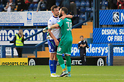Bury defender Eoghan O'Connell (6) embraces Bury goalkeeper Leonardo Fasan (38) during the EFL Sky Bet League 1 match between Bury and Bradford City at the Energy Check Stadium at Gigg Lane, Bury, England on 14 October 2017. Photo by Richard Holmes.