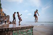 Boys diving into the river Ganges from a riverside ghat, Assi Ghat, River Ganges, Varanasi, India