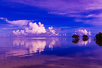 Sunrise reflecting on still water, Nukubati Island Resort, Fiji Islands