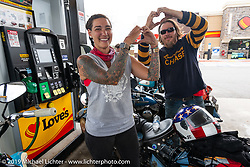 Jody Perewitz showing some love at a gas stop with her 1936 Harley-Davidson VLH and Jason Sims during the Cross Country Chase motorcycle endurance run from Sault Sainte Marie, MI to Key West, FL. (for vintage bikes from 1930-1948). 287 mile ride of Stage-8 from Tallahassee to Lakeland, FL USA. Friday, September 13, 2019. Photography ©2019 Michael Lichter.`
