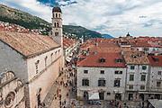 The Franciscan Monastery and tourists on the Stradun, old town Dubrovnik, Dalmatian Coast, Croatia