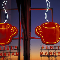 USA, Washington, Seattle, Neon coffee and market signs at Pike Place Market on winter evening