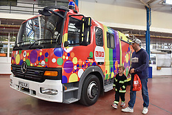 © Licensed to London News Pictures. 09/09/2017. London, UK. Visitors view a Mercedes 1325F TVAC DPL1101 2002 fire engine on show at London Fire Brigade's annual Fire Engine Festival in Lambeth. The vehicle has been decorated in rainbow colours for London's annual Pride festival.  The earliest motorised fire engines still working, London Fire Brigade's brand new pump as well firefighter uniforms are on display. Photo credit : Stephen Chung/LNP