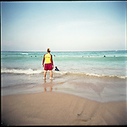 Surf rescue lifeguard on Manly Beach. Picture taken with a Holga. Surf rescue on the beach, yellow and red.