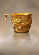 Vapheio type Mycenaean gold cup depicting a wild bull hunt side C , Vapheio Tholos Tomb, Lakonia, Greece. National Archaeological Museum of Athens. <br /> <br />  Two masterpieces of Creto - Mycenaean gold metalwork were excavated from a tholos tomb near Lakonia in Sparta in 1988. Made in the 15th century BC, the gold cups are heavily influenced by the Minoan style that was predominant in the Agean at the time. The bull hunt was popular with  Mycenaean  and Minoan artists and symolised power and fertility. The distinctive shape of the cup is kown as 'Vapheio type'. .<br /> <br /> If you prefer to buy from our ALAMY PHOTO LIBRARY  Collection visit : https://www.alamy.com/portfolio/paul-williams-funkystock/mycenaean-art-artefacts.html . Type -   Athens    - into the LOWER SEARCH WITHIN GALLERY box. Refine search by adding background colour, place, museum etc<br /> <br /> Visit our MYCENAEN ART PHOTO COLLECTIONS for more photos to download  as wall art prints https://funkystock.photoshelter.com/gallery-collection/Pictures-Images-of-Ancient-Mycenaean-Art-Artefacts-Archaeology-Sites/C0000xRC5WLQcbhQ