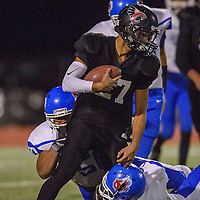 Crownpoint Eagle Isaiah Pool (27) maneuvers through the McCurdy Bobcat defense Friday at Crownpoint High School.