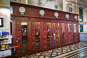 28 MARCH 2012 - HO CHI MINH CITY, VIETNAM:    Long distance phone booths in the main post office in Ho Chi Minh City, Vietnam. The main Post Office is a landmark and popular with tourists who visit Vietnam.       PHOTO BY JACK KURTZ