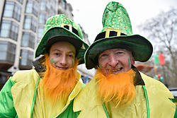 © Licensed to London News Pictures. 18/03/2018. LONDON, UK. Performers dress as leprechauns join the 16th annual London St. Patrick's Day parade taking place through central London.  Tens of thousands of people enjoy the parade as well as festivities in Trafalgar Square.  The event showcases the best of Irish food, music, song, dance, culture and arts and this year, celebrates the achievements and successes of London's Irish women as part of the Mayor of London's #BehindEveryGreatCity campaign.   Photo credit: Stephen Chung/LNP