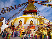 07 MARCH 2017 - KATHMANDU, NEPAL: Statues of the Buddha on the ledge of Boudhanath Stupa during the consecration ceremony. Boudhanath Stupa, the most important Buddhist site in Nepal and a popular tourist attraction, was consecrated Tuesday in a ceremony attended by thousands of Buddhist monks and Buddhist people from Nepal and Tibet. The stupa was badly damaged in the 2015 earthquake that devastated Nepal. The stupa, which reopened in November 2016, was repaired in about 18 months. The repair was financed by private donations raised by international Buddhist organizations.     PHOTO BY JACK KURTZ