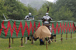 © Licensed to London News Pictures. 15/06/2013. Eltham, United Kingdom. A medieval joust went ahead at historic Eltham Palace in south east London despite a downpouring of heavy rain. credit : Rob Powell/LNP