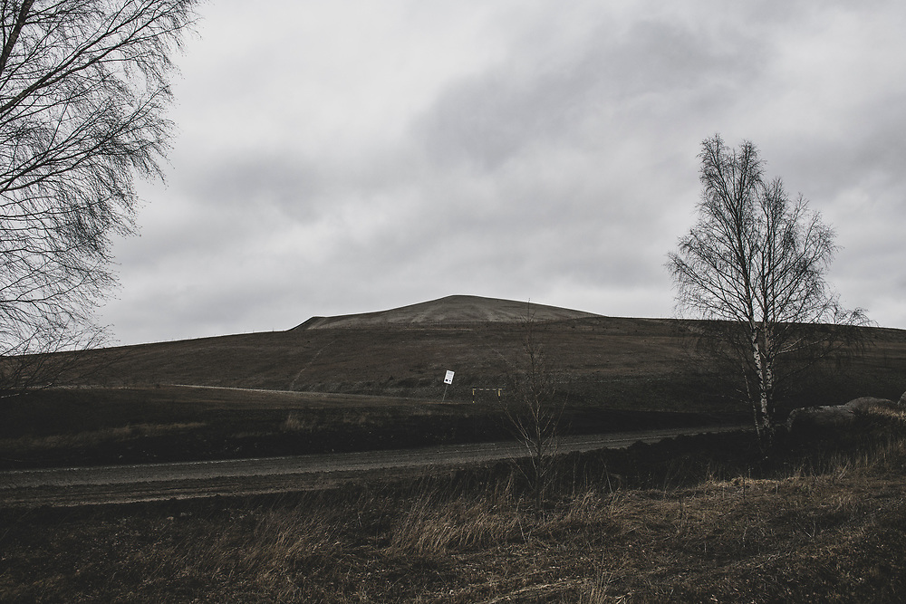 Kiviõli, Estonia - February 22, 2020: One of the many shale ash hills that dot the landscape in northeastern Estonia. These artificial hills are made from the waste ash produced when oil shale, a sedimentary rock that is abundant in the region, is processed into power or oil.