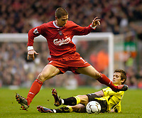 Photo. Jed Wee.<br /> Liverpool v Aston Villa, FA Barclaycard Premiership, Anfield, Liverpool. 10/01/2004.<br /> Liverpool's Harry Kewell (L) hurdles over a challenge from Aston Villa's Lee Hendrie.