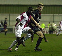 Picture: Raymond Field<br /><br /><br />Woking F.C v Kidderminster Harriers FA second round<br /><br />06/12/2003<br /><br /><br />Amos Foyewa trying to put the brakes on Bo Henriksen