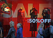 © Licensed to London News Pictures. 09/12/2011, London, UK. Crowds walk past sale signs on Regent Street. Christmas shoppers in London's Oxford Street and Regent Street today 09 December 2011. Some of the shops are already having sales and displaying prices in windows. Photo credit : Stephen Simpson/LNP