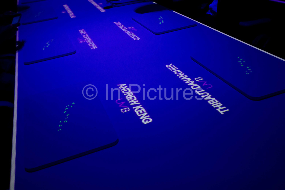 Names of diners are projected onto the table at Chef Paul Pairet's Ultra Violet (UV) restaurant in Shanghai, China on 28 September 2013. Serving only a dozen patrons per meal, UV is quickly making a reputation for itself as it combines the senses of taste, sound, and sight to the extreme.