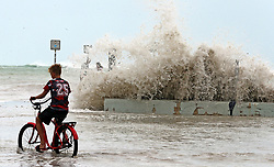 A Key West resident watches as waves crash onto a seawall in Key West, FL, USA., on Saturday, September 9, 2017. Hurricane Irma is approaching the Florida Keys with many residents refusing to be evacuated. Photo by Charles Trainor Jr./Miami Herald/TNS/ABACAPRESS.COM