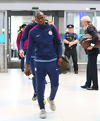 Yaya Toure as the Manchester City team arrive at Manchester Airport as they jet for Iceland