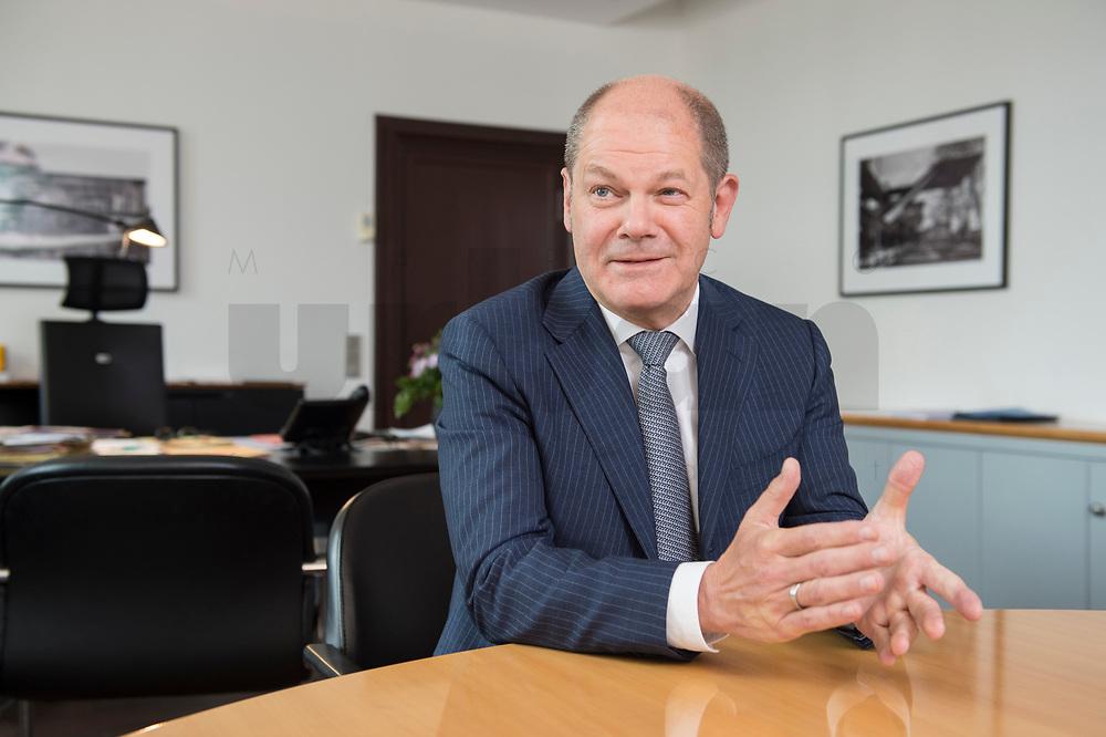 25 JUN 2018, BERLIN/GERMANY:<br /> Olaf Scholz, SPD, Bundesfinanzminister, waehrend einem Interview, in seinem Buero, Bundesministerium der Finanzen<br /> IMAGE: 20180625-02-014<br /> KEYWORDS: Büro