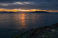 A winter sunset over Lummi Island from Clayton Beach in Larrabee State Park - Bellingham, Washington State, USA