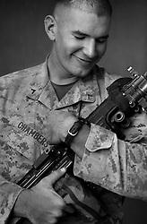 PFC Jon Chambers, 21, Portland, Oregon, Weapons Platoon, Kilo Co., 3rd Battalion 1st Marines, United States Marine Corps, at the company's firm base in Haditha, Iraq on Sunday Oct. 22, 2005.
