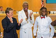 Marmion Dambrino and Trustee Jolanda Jones congratulate Brandolyn Walker during a meeting of the Board of Trustees, June 9, 2016.