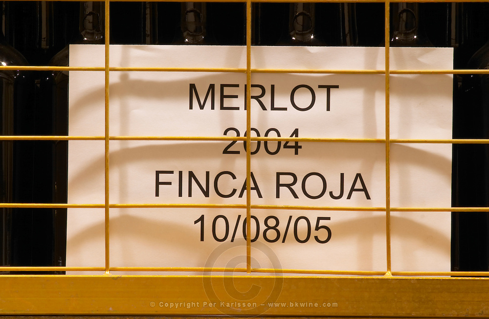 Wire cage with bottles of Merlot 2004 Finca Roja Bodega Del Anelo Winery, also called Finca Roja, Anelo Region, Neuquen, Patagonia, Argentina, South America