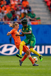 15-06-2019 FRA: Netherlands - Cameroon, Valenciennes<br /> FIFA Women's World Cup France group E match between Netherlands and Cameroon at Stade du Hainaut / Anouk Dekker #6 of the Netherlands, Gaëlle Enganamouit #17 of Cameroon