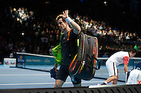 Andy Murray (GBR) walks from the court after his defeat by Kei Nishikori (JPN) in their Group B Singles match - Kei Nishikori (JPN) def Andy Murray (GBR) 6-4 6-4<br /> <br /> Photographer Stephen White/CameraSport<br /> <br /> International Tennis - Barclays ATP World Tour Finals - O2 Arena - London - Day 1 -  Sunday 9th November 2014<br /> <br /> © CameraSport - 43 Linden Ave. Countesthorpe. Leicester. England. LE8 5PG - Tel: +44 (0) 116 277 4147 - admin@camerasport.com - www.camerasport.com