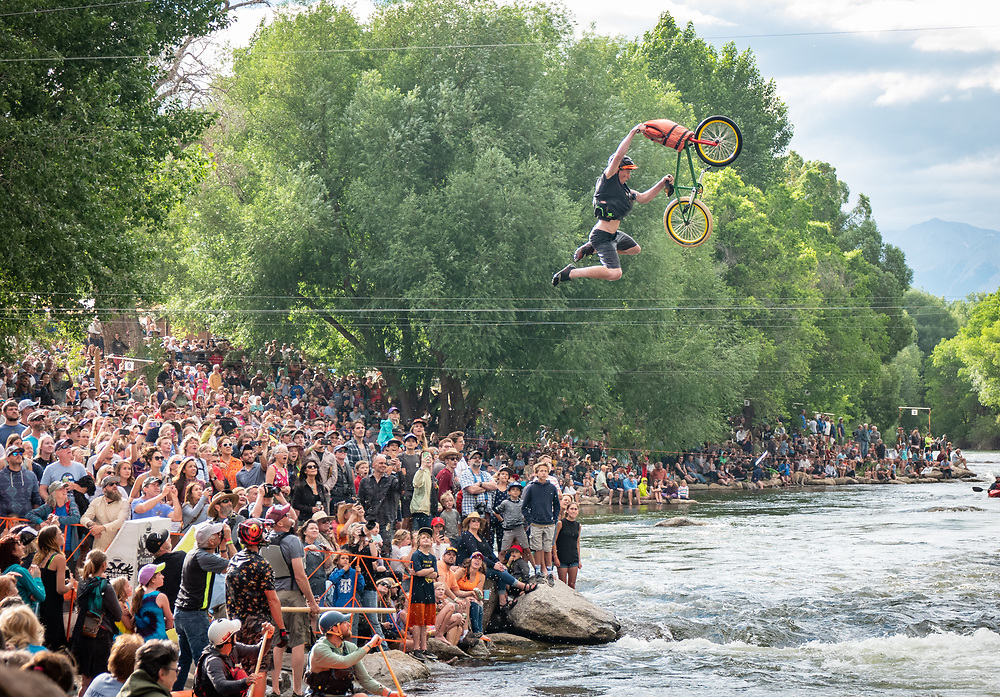 A trick cyclist pushes clear of his bike before both plummet into the Arkansas River during the Hooligan Race at the Fib Ark River Festival in Salida on Saturday afternoon, June 16, 2018.