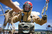A rookie smoke jumper organizes himself after a tower jump at the McCall, ID smokejumper base.