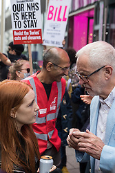 London, UK. 5th July, 2021. Student Patsy Stevenson, who was arrested at the Sarah Everard vigil, speaks to former Labour Party leader Jeremy Corbyn at a rally organised by Doctors in Unite outside the Department of Health and Social Care. The rally was organised to mark the 73rd birthday of the National Health Service and in protest against the sale of one of the UK's biggest GP practice operators to the US health insurance group Centene Corporation.