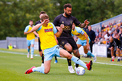 Shaun Raggett of Rotherham United sticks a leg out to gain possession from Craig Davies of Mansfield Town - Mandatory by-line: Ryan Crockett/JMP - 28/07/2018 - FOOTBALL - One Call Stadium - Mansfield, England - Mansfield Town v Rotherham United - Pre-season friendly