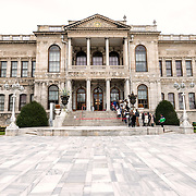The exterior of the administrative building at Dolmabahçe Palace. Dolmabahçe Palace, on the banks of the Bosphorus Strait, was the administrative center of the Ottoman Empire from 1856 to 1887 and 1909 to 1922. Built and decorated in the Ottoman Baroque style, it stretches along a section of the European coast of the Bosphorus Strait in central Istanbul.